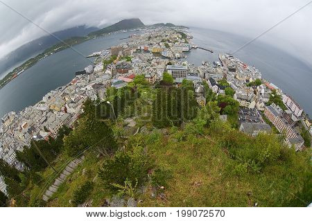ALESUND, NORWAY - JUNE 03, 2010: Wide angle wiew to the Alesund city on a cloudy summer day in Alesund, Norway.