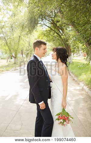 Beautiful just married couple outdoors in the day light