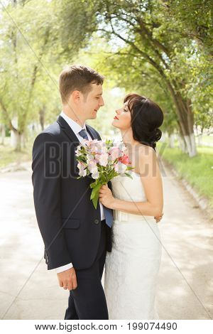 Beautiful just married couple outdoors in day lihgt
