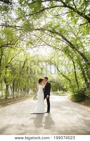 Beautiful just married couple outdoors in day light