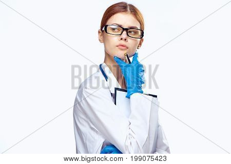 Young beautiful woman in glasses on white isolated background in medical dressing gown, doctor, medicine.