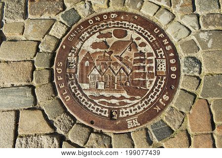 BERGEN, NORWAY - JUNE 06, 2010: Exterior of the traditional decorated sewer manhole in Bergen, Norway.