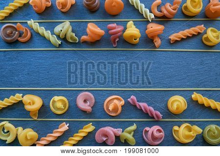 Five Rows Of Pasta With One Empty Row