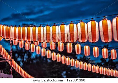red and orange paper japanese lantern vintage color at night sky