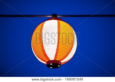 One japanese lantern on blue night background