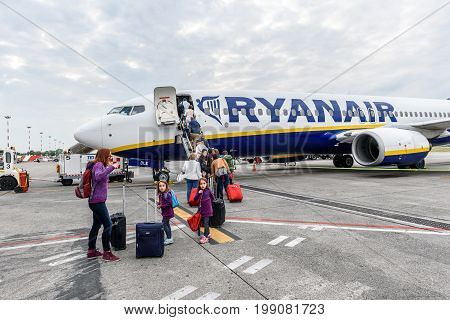Milano Italy - MAY 10 2017: Passengers boarding Ryanair flight from Milano Italy to Santiago de Compostela Spain on a cloudy day. Ryanair is biggest budget low-cost airline in the world.
