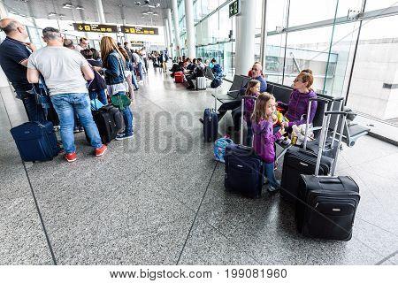 SANTIAGO DE COMPOSTELA SPAIN - MAY 19 2017: Passengers waiting in line at airport terminal before boarding Ryanair plane to Milano.