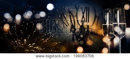 New Year panorama background with fireworks and twelve o'clock for congratulations