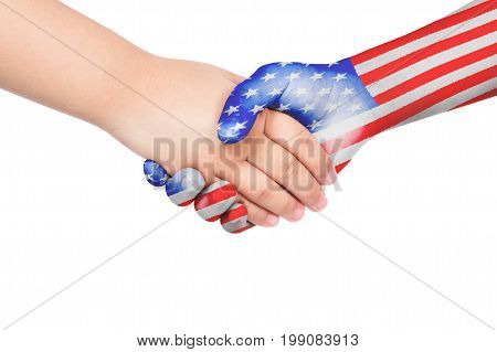 Handshake between a child and United States of America with flags painted on hand in isolated white background