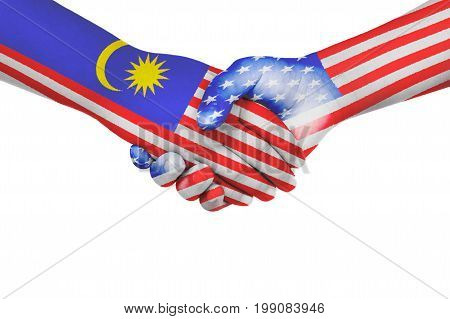 Handshake between Malaysia and United States of America with flags painted on child's hands in isolated white background
