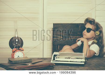 Kid choose career in glasses. Small girl with curler in hair. Education and childhood. Child with briefcase and alarm clock. Little baby secretary.