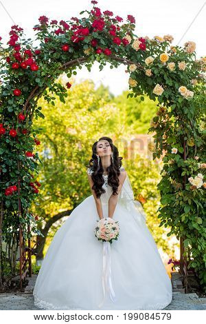 Woman With Dress And Veil At Rose Bouquet.