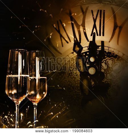 Time for new year congratulations with champagne and a clock in background