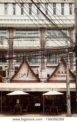 Pattaya Thailand - March 28 2016: Empty roadside outdoor bar at urban Asian city slum. Old dirty building exterior on a Thailand town street
