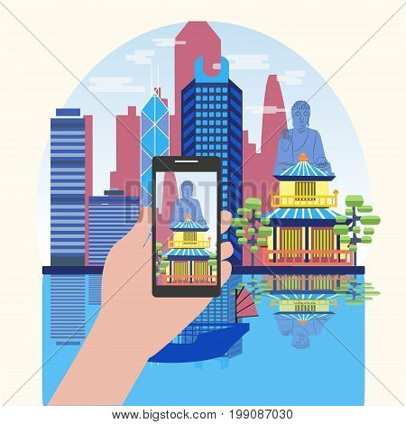 Hand holding phone with skyline landscape on screen. Vacation booking concept. Smart Phone Taking Photo Of Attractive Hong Kong travel concept.
