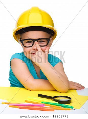 Cute Little Girl Is Playing While Wearing Hard Hat