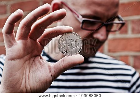 Man Holding Litecoin In His Hand