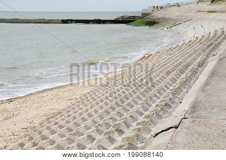 Coastal protection blocks with sea in background