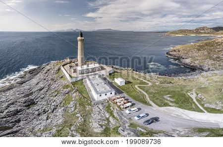 Stunning aerial shot of Ardnamurchan Point, Great Britains most westerly point, with lighthouse and the beautiful white beaches and costline in the background, Scotland
