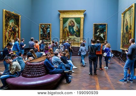 Dresden Germany - July 26 2017. Tourists view the painting of Raphael's Sistine Madonna (C) in the Dresden Picture Gallery of Old Masters.