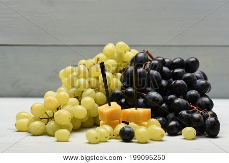 Composition Of Marble Cheese Skewers And Grapes