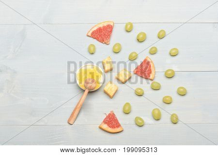 Composition Of Marble Cheese, Grapes, Grapefruit And Honey