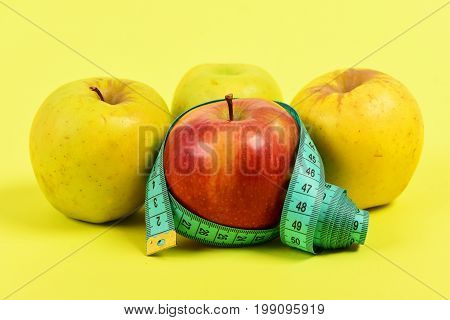 Apples Of Red And Yellow Colour With Cyan Measuring Tape