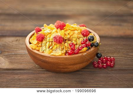 Breakfast Of Cornflakes With Berries In Wooden Bowl