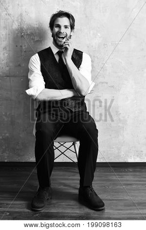Happy Fashion Business Man Sitting On Chair