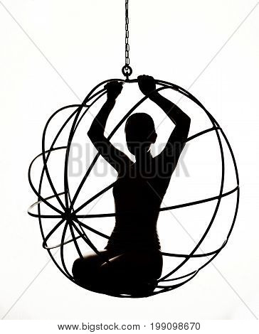 Silhouette of a sexy woman on a metal swing, black and white.