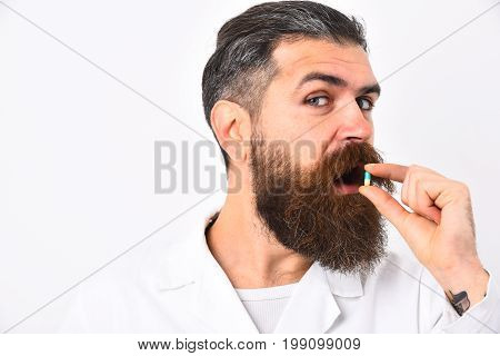 Doctor With Beard Dressed In White Gown. Medicine And Health