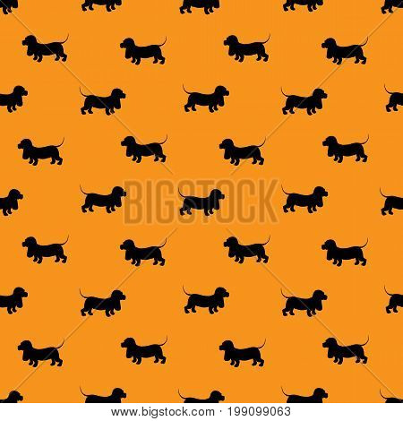 Seamless pattern with black dogs silhouettes - Dachshund on orange background. Animal design.