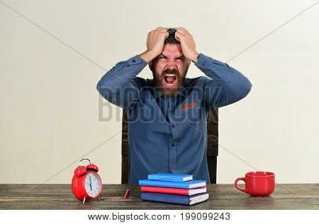 Exam And Studying Concept. Man With Beard Holds His Head