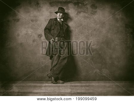 Classic Wet Plate Photo Of Mysterious Vintage 1900 Western Man Standing Against Wall.