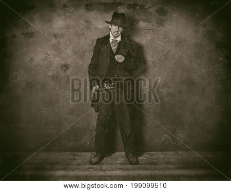 Classic Wet Plate Photo Of 1900 Western Man Standing With Cigarette Against Wall.