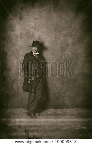 Classic Wet Plate Photo Of Mysterious 1900 Western Man Standing Against Wall.