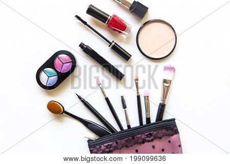 Cosmetics and fashion background with make up artist objects: lipstick eye shadows mascara eyeliner concealer nail polish. Lifestyle Concept