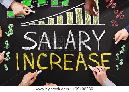 Hands Drawing Salary Increase Concept On Blackboard