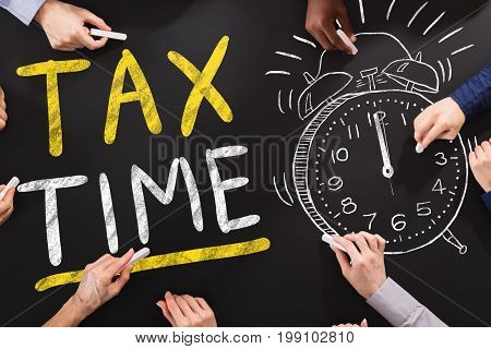 Hand Drawing Tax Time Concept On Blackboard