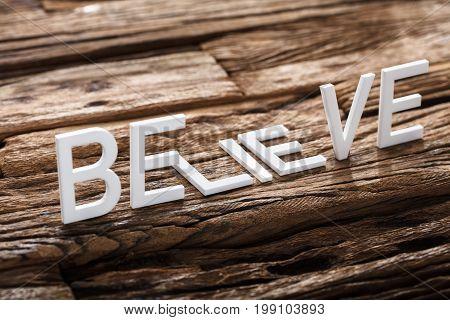 Closeup of believe or lie words on wood