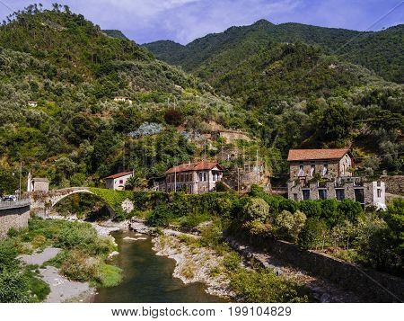 Photo of the stone bridge and river in the small old town of Badalucco in Italy in the province of Imperia the Italian region Liguria.