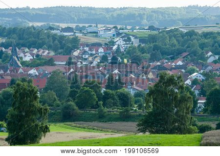 NEUSTADT GERMANY - JULY 30 2017: View of the small town of Neustadt (Marburg-Biedenkopf district in Hessen) a suburb and surrounding agricultural land.