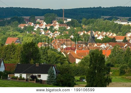 NEUSTADT GERMANY - JULY 31 2017: View of the small town of Neustadt (Marburg-Biedenkopf district in Hessen) the suburbs and surrounding agricultural land in the morning sun.