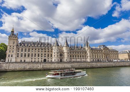 Tourist Boat On River Seine By Conciergerie In Paris, France
