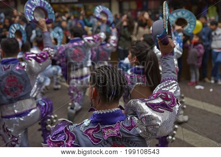 Santiago, Chile - August 5, 2017: Caporales dance group parading through the centre of Santiago, Chile to mark Independence Day of Bolivia.