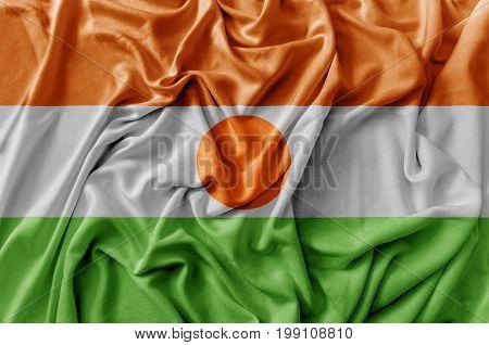 Ruffled waving Niger flag national close up