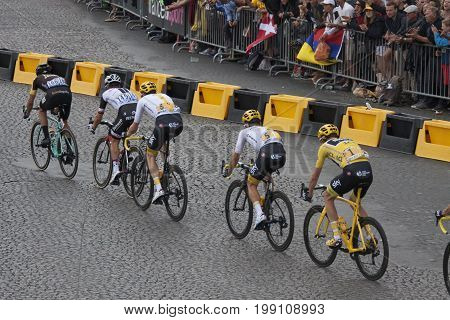PARIJS , FRANKRIJK - JULY 23 ,2017: Cyclists chris froome with the yellow sweater ride the champs elysees and he becomes the winner of the tour the france