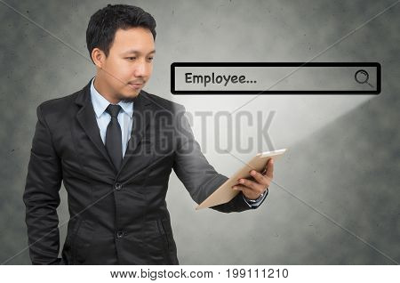 Asian businessman using the tablet with browsing of Internet searching