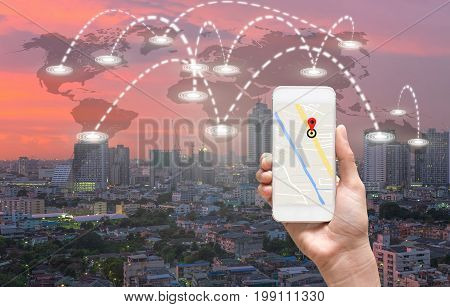 female hands holding a smart phone showing part of navigator map over screen on connection line over the world map with cityscape Navigation conceptElements of this image furnished by NASA,