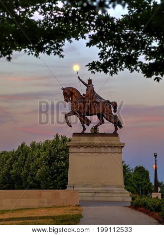 July 7 2017 - St. Louis Missouri - The sunset over the Apotheosis of St. Louis statue of King Louis IX of France namesake of St. Louis Missouri in Forest Park St. Louis Missouri.